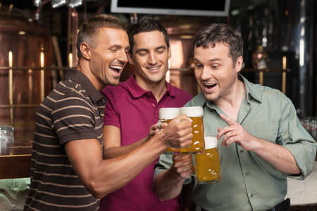 23778757-old-friends-three-happy-friends-drinking-beer-at-the-pub-6029476